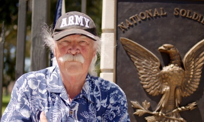 Vietnam War veteran Robert Rosebrock stands in front of the Veteran Affairs (VA) Greater Los Angeles Healthcare System campus to protest uses of the campus he says do not serve veterans, on June 7, 2020. (Hau Nguyen/The Epoch Times)