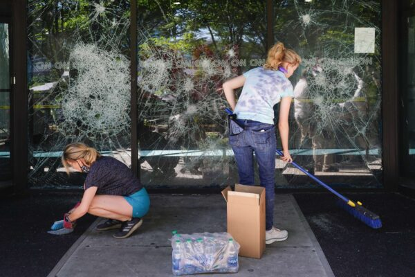 People clean up damage to CNN Center