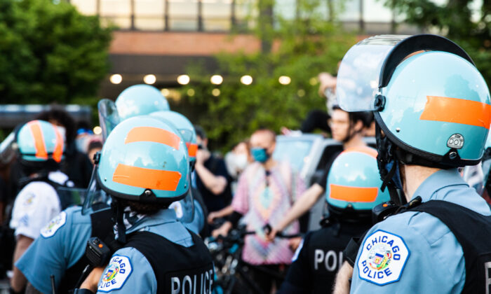 Chicago Police Department officers gather as curfew nears during a demonstration in Chicago, Ill., on June 6, 2020. (Natasha Moustache/Getty Images)