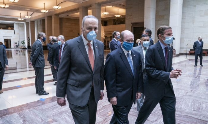 Senate Minority Leader Chuck Schumer (D-N.Y.), left, departs from a moment of silence held to honor George Floyd and the Black Lives Matter movement in Emancipation Hall of the U.S. Capitol in Washington on June 4, 2020. (Sarah Silbiger/Getty Images)