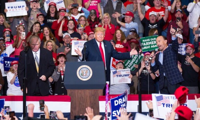 (L-R) Commentator Rush Limbaugh, President Donald Trump, and singer Lee Greenwood at a Make America Great Again rally in Cape Girardeau, Mo., on Nov. 5, 2018. (Hu Chen/The Epoch Times)