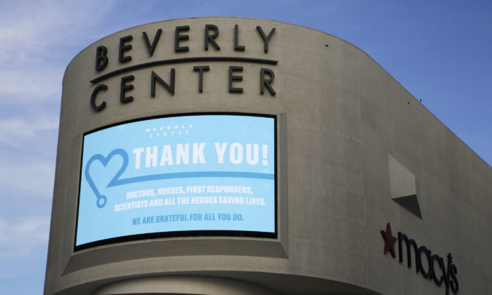"""An electronic banner thanks """"doctors, nurses, first responders, scientists and all the heroes saving lives"""" during the CCP virus pandemic, at Beverly Center mall across from Cedars-Sinai Medical Center owned by Simon Properties in West Hollywood, Calif., on May 6, 2020. (Damian Dovarganes/AP Photo)"""