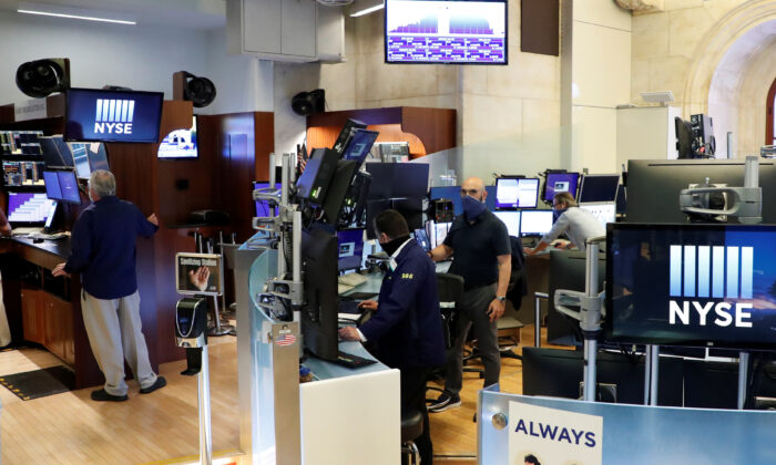 Traders work inside posts, on the first day of in-person trading since the closure during the CCP virus outbreak on the floor at the New York Stock Exchange (NYSE) in New York, on May 26, 2020. (Brendan McDermid/Reuters)