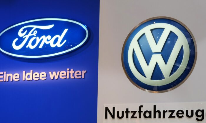 "The logos of car makers Ford (L) and Volkswagen (VW, R) are seen at the expo ""Caravan Salon Duesseldorf"" at the fair grounds in Duesseldorf, western Germany, on Aug. 31, 2014. (Patrik Stollarz/AFP via Getty Images)"