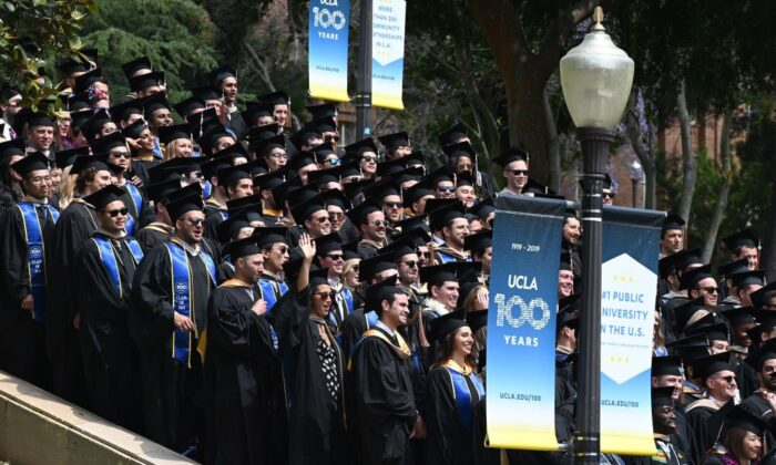 Graduating students pose for a class picture at the University of California Los Angeles (UCLA) in Los Angeles on June 14, 2019. (ROBYN BECK/AFP via Getty Images)