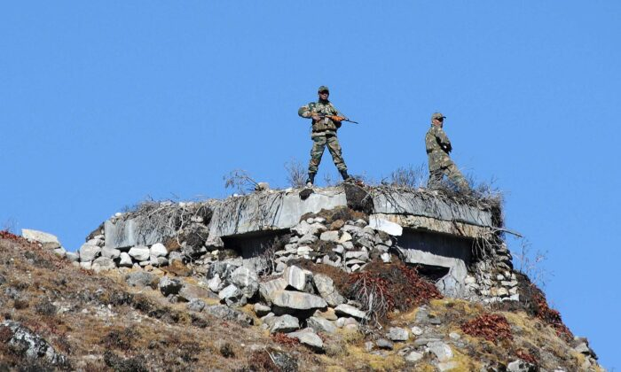Indian Army personnel keep vigilance at Bumla pass at the India-China border in Arunachal Pradesh on Oct. 21, 2012. (Biju Boro/AFP via Getty Images)
