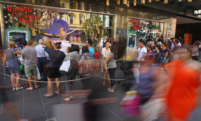 People walk past the Myer Christmas window display as they do their Christmas shopping on December 20, 2012 in Melbourne, Australia. (Scott Barbour/Getty Images)