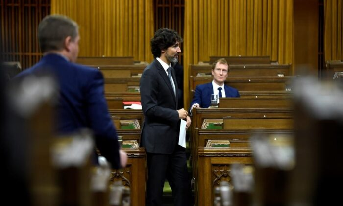 Prime Minister Justin Trudeau rises during a meeting of the Special Committee on the COVID-19 Pandemic in the House of Commons on Parliament Hill in Ottawa, on June 9, 2020. (Justin Tang/The Canadian Press)