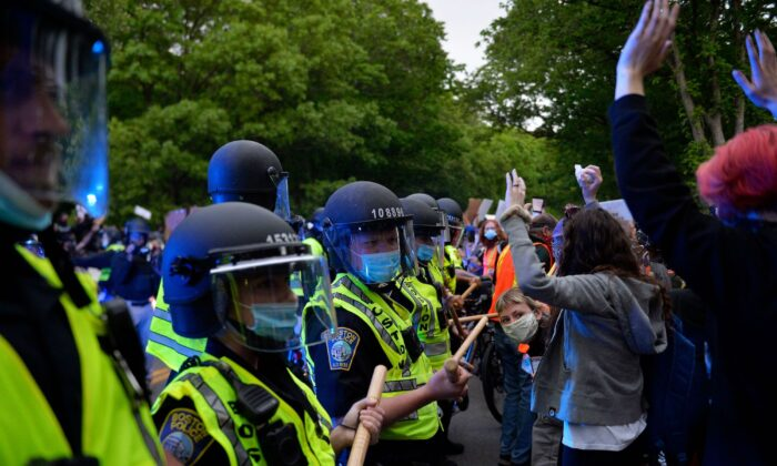 Protesters confront a row of police officers at a demonstration in Franklin Park in Boston, Mass., on June 2, 2020. (Joseph Prezioso/AFP via Getty Images)