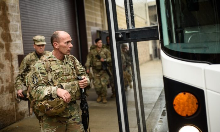 U.S. troops from the Army's 82nd Airborne Division board a bus as they head out for a deployment to the Middle East in Fort Bragg, N.C., on Jan. 4, 2020. (Andrew Craft/Getty Images)