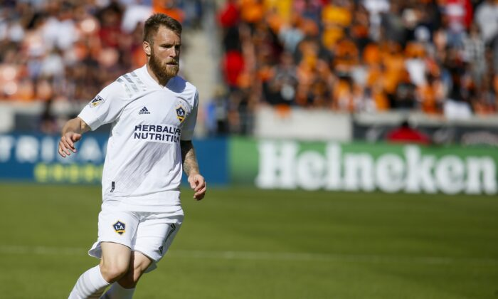 Aleksandar Katai #7 of Los Angeles Galaxy brings the ball up field against the Houston Dynamo at BBVA Stadium in Houston, Texas, on Feb. 29, 2020. (Bob Levey/Getty Images)