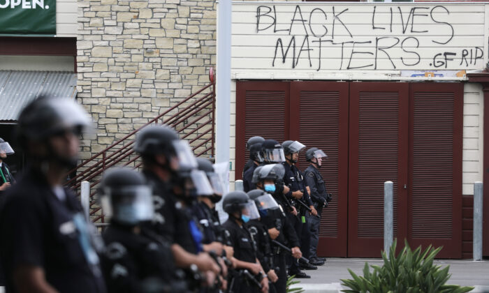 LAPD officers keep watch during demonstrations following the death of George Floyd, in Los Angeles, Calif., on May 30, 2020. (Mario Tama/Getty Images)