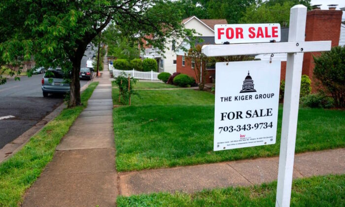 """A """"For Sale"""" sign is in front of a house in Arlington, Va., on May 6, 2020. (ANDREW CABALLERO-REYNOLDS/AFP via Getty Images)"""