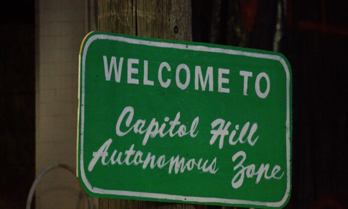 """A sign outside Seattle's so-called """"Capitol Hill Autonomous Zone,"""" in Seattle, Wash., on June 10, 2020. (David Ryder/Getty Images)"""