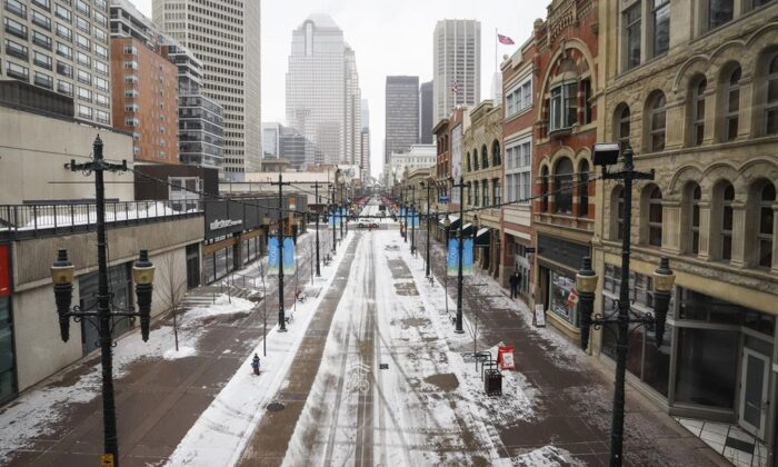 Empty downtown streets in Calgary, Alta. on March 18, 2020, amid a worldwide COVID-19 pandemic. (Jeff McIntosh/The Canadian Press)