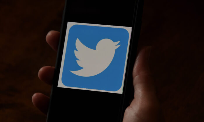 A Twitter logo is displayed on a mobile phone in Arlington, Va. on May 27, 2020. (Olivier Douliery/AFP via Getty Images)