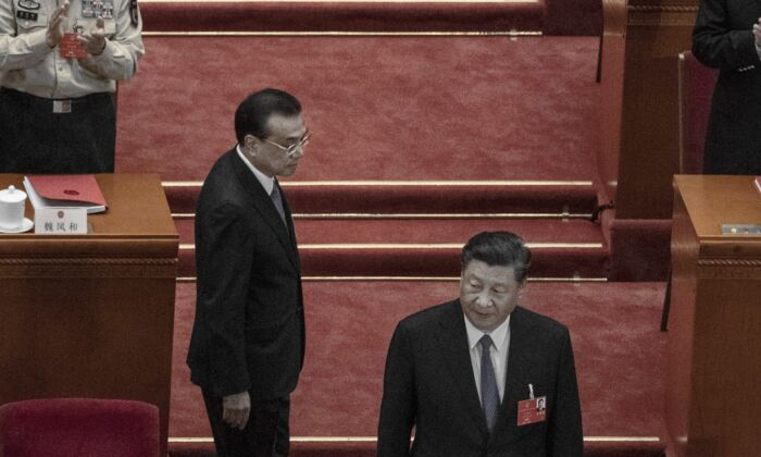 Chinese leader Xi Jinping and premier Li Keqiang arrived at the closing session of the party's rubber stamp legislature's congress in Beijing, China on May 28, 2020. (Kevin Frayer/Getty Images)