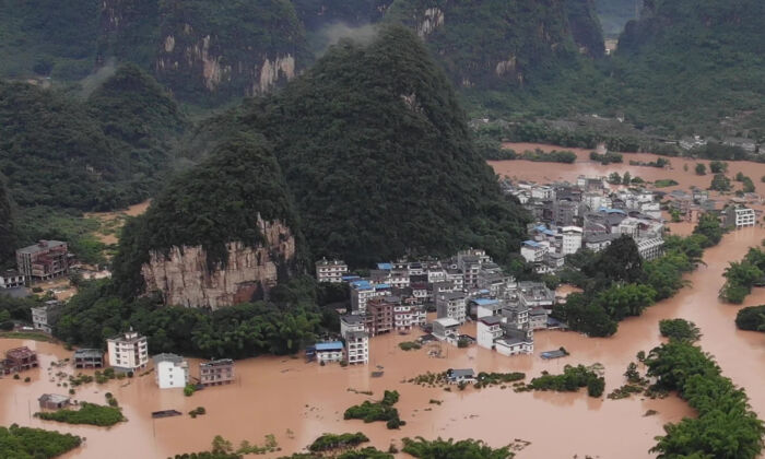 Streets and buildings are submerged under flood water in Yangshuo, in China's southern Guangxi region on June 7, 2020. (STR/AFP via Getty Images)
