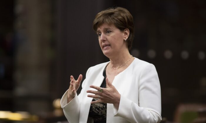Minister of Agriculture and Agri-Food Minister Marie-Claude Bibeau rises during a sitting of the Special Committee on the COVID-19 Pandemic in the House of Commons, in Ottawa, Canada, on June 3, 2020. (Adrian Wyld/The Canadian Press)
