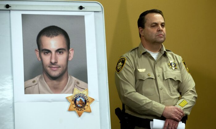 Las Vegas Police Assistant Sheriff Chris Jones stands by a photo of Metro Police officer Shay K. Mikalonis, 29, a four-year veteran of the department, during a media briefing at police headquarters in Las Vegas on June 2, 2020. (Steve Marcus/Las Vegas Sun via AP)
