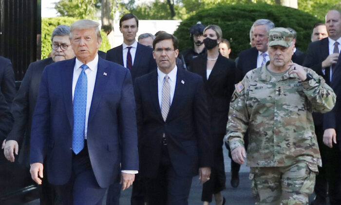 President Donald Trump departs the White House to visit outside St. John's Church, with Secretary of Defense Mark Esper, center, Joint Staffs chairman Mark Milley, right, and other officials, in Washington on June 1, 2020. (Patrick Semansky/AP Photo)