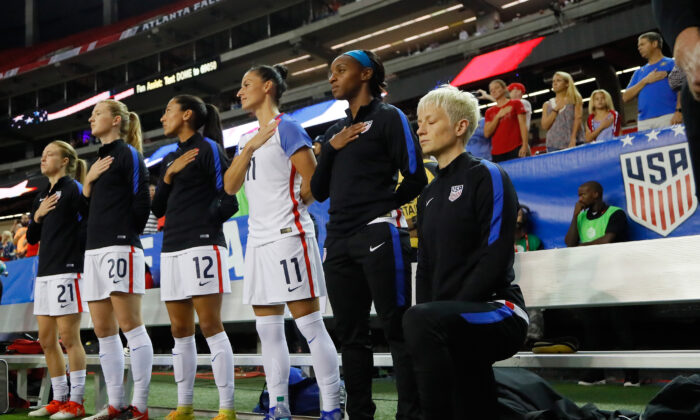 Megan Rapinoe kneels during the National Anthem prior to the match between the United States and the Netherlands at Georgia Dome in Atlanta, Ga., on Sept. 18, 2016. (Kevin C. Cox/Getty Images)