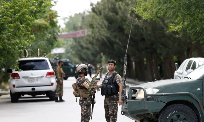 Afghan security forces stand guard near the site of an attack in Kabul, Afghanistan, on June 12, 2020. (Mohammad Ismail/Reuters)