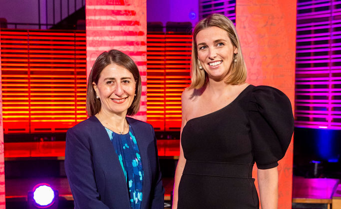 Grace Brennan with the NSW Premier, Gladys Berejiklian after delivering the 2020 Australia Day Address on January 21, 2020 in Sydney, Australia. Grace Brennan founded the #buyfromthebush social media campaign. (Jenny Evans/Getty Images)