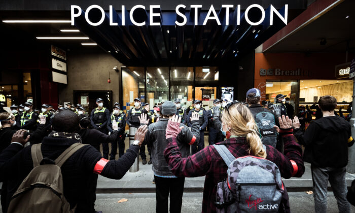 Protestors stand in front of Police to prevent conflict in Melbourne, Australia on June 6, 2020. (Darrian Traynor/Getty Images)