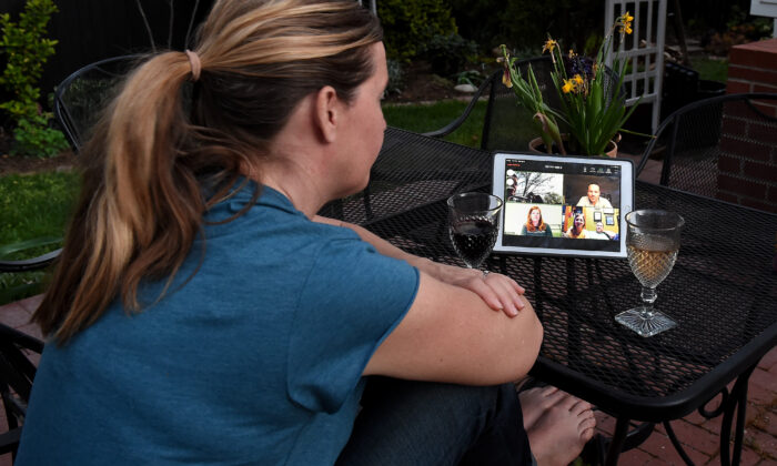 A woman enjoys a virtual happy hour during the coronavirus (Covid-19) crisis in Arlington, Virginia, on April 8, 2020. (Olivier Douliery/AFP via Getty Images)