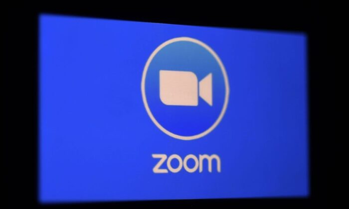 A Zoom App logo is displayed on a smartphone. (Olivier Douliery/AFP via Getty Images)