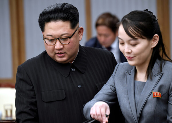 North Korean leader Kim Jong Un and his sister Kim Yo Jong attend a meeting