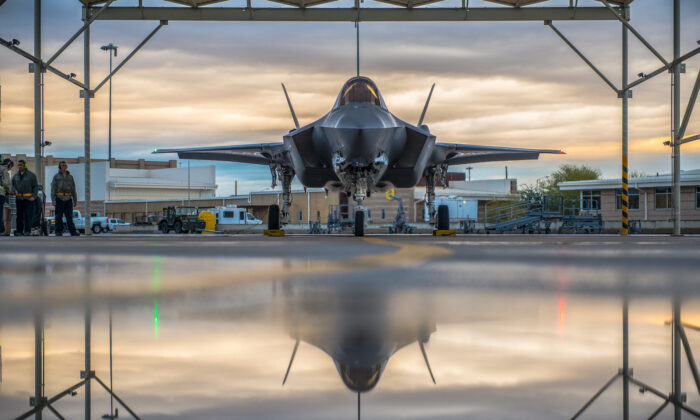 A pilot assigned to the 61st Fighter Squadron and 61st Aircraft Maintenance Unit crew chiefs prepare an F-35A Lightning II for taxi, Jan. 15, 2019 at Luke Air Force Base, Ariz. (Airman 1st Class Jacob Wongwai/U.S Air Force)