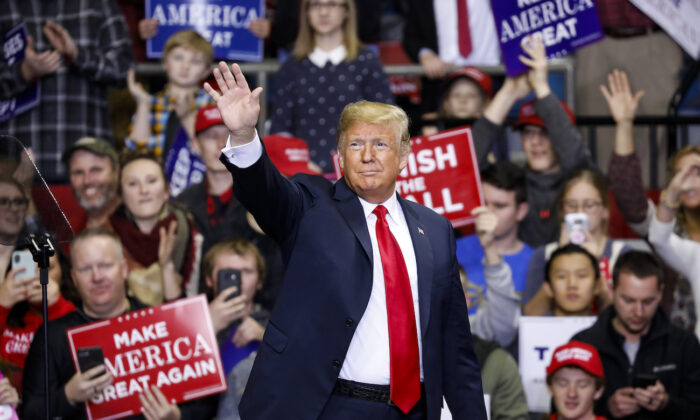 President Donald Trump arrives at a campaign rally for Republican Senate candidate Mike Braun at the County War Memorial Coliseum in Fort Wayne, Indiana on Nov. 5, 2018. (Aaron P. Bernstein/Getty Images)