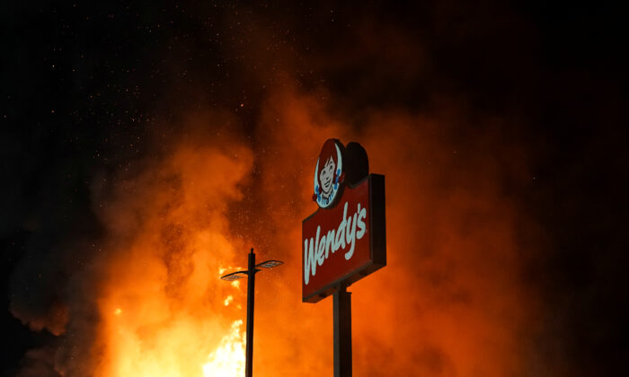 Wendy's burns following a rally against racial inequality and the police shooting death of Rayshard Brooks in Atlanta, Ga., on June 13, 2020. (Elijah Nouvelage/Reuters)