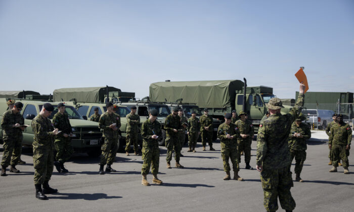 Members of the Canadian Forces jot down directions at Denison Ermine to convoy to CFB Borden amid the distribute of COVID-19 on 04 6, 2020 in Toronto, Canada. (Photo by Cole Burston/Getty Images)