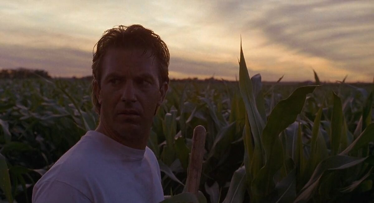 """man with white t-shirt in cornfield in """"Field of Dreams"""""""