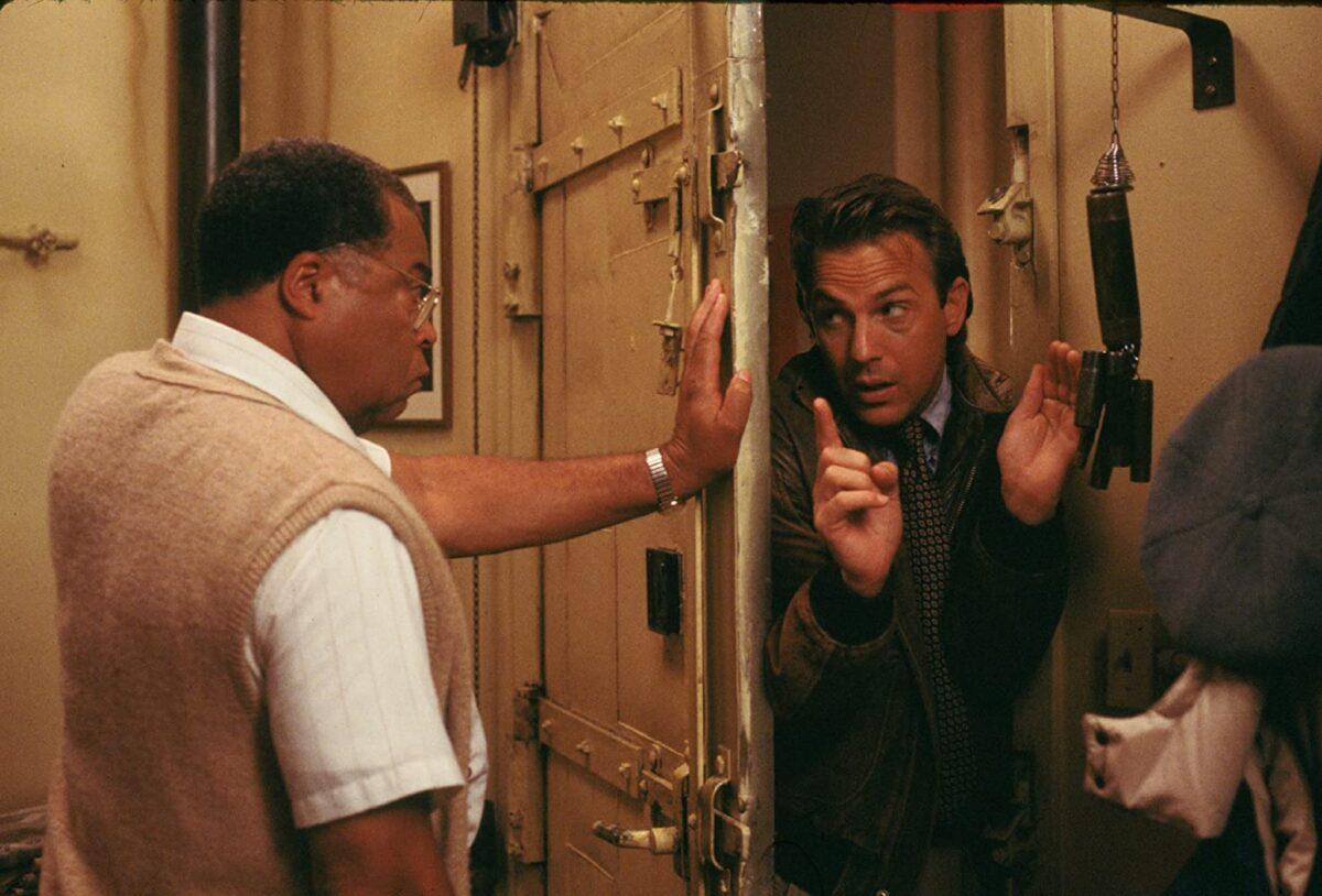 "man shutting door on another man in ""Field of Dreams"""