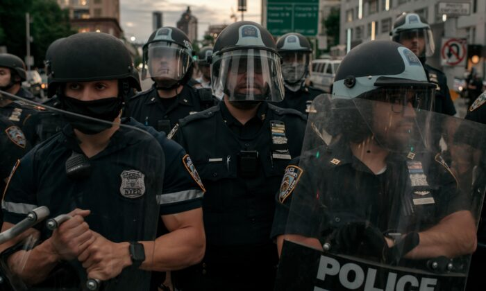 NYPD officers block the entrance of the Manhattan Bridge in New York City on June 2, 2020. (Scott Heins/Getty Images)