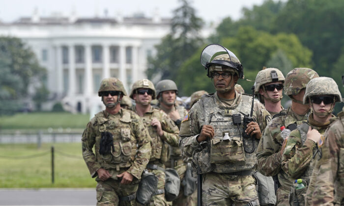 National Guard members deploy near the White House as peaceful protests are scheduled against police brutality and the death of George Floyd, in Washington, on June 6, 2020. (Drew Angerer/Getty Images)