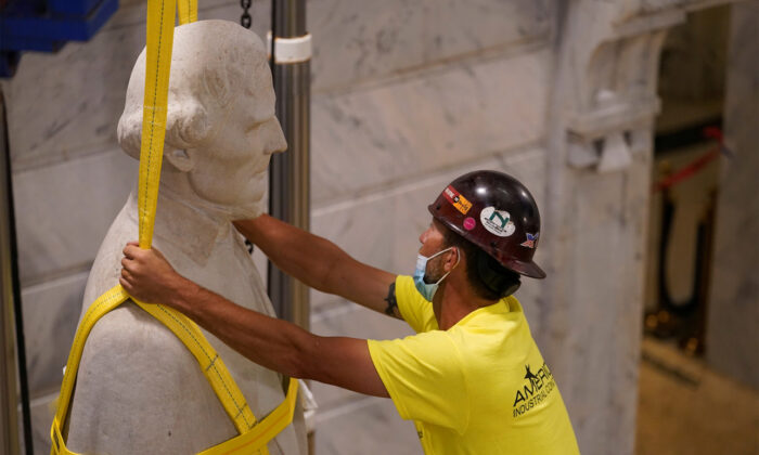 Artifacts were found inside of the base of the Jefferson Davis statue during its removal Saturday. (Reuters)