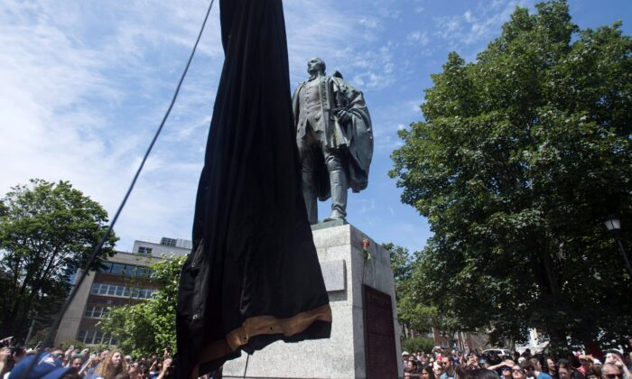 The statue of Edward Cornwallis, the founder of Halifax, is about to be covered as activists protest in Cornwallis Park in Halifax on July 15, 2017. The statue was removed on Jan. 31, 2018. (The Canadian Press/Darren Calabrese)
