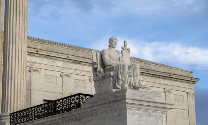 The Authority of Law statue of the Supreme Court in Washington on March 10, 2020. (Samira Bouaou/The Epoch Times)