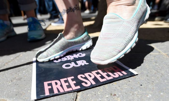 A woman stomps on a free speech sign at the University of California–Berkeley in Berkeley, Calif., on Sept. 24, 2017. (Josh Edelson/AFP/Getty Images)
