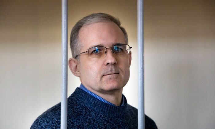 Paul Whelan, a former U.S. marine who was arrested for alleged spying in Moscow on Dec. 28, 2018, stands in a cage as he waits for a hearing in a court room in Moscow, Russia, on Aug. 23, 2019. (Alexander Zemlianichenko/AP Photo)
