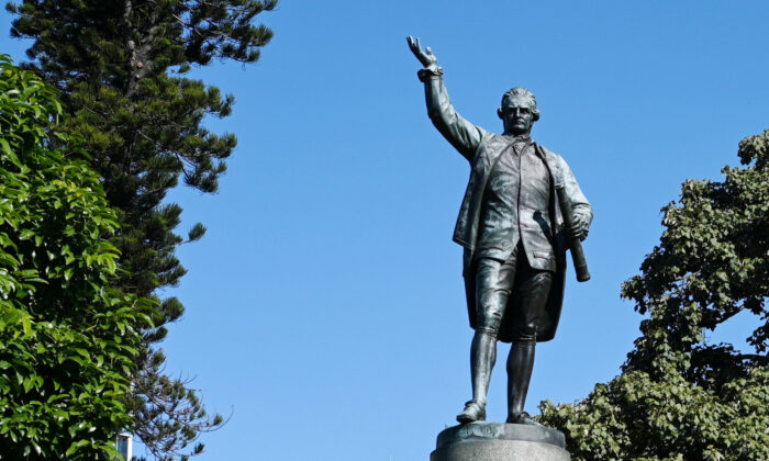 Two women have been charged for allegedly spraying graffiti on a statue of Captain James Cook in Sydney's Hyde Park on June 14. (William West/Getty Images)