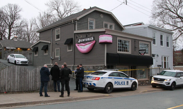 Regional police investigators confer outside the Atlantic Denture Clinic in Dartmouth, Nova Scotia, Canada, on April 20, 2020. (Tim Krochak/Getty Images)