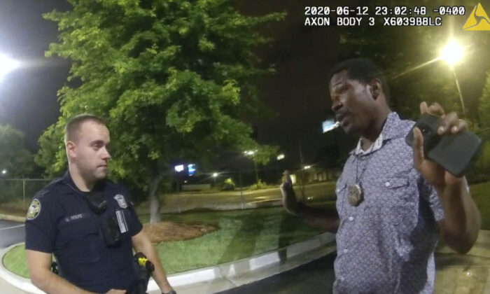 Rayshard Brooks speaking with Officer Garrett Rolfe in the parking lot of a Wendy's restaurant, in Atlanta, Ga., late on June 12, 2020. (Atlanta Police Department via AP)