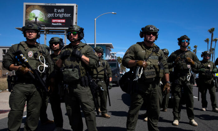 Huntington Beach SWAT team members stand ready for protesters, after violent demonstrations in response to George Floyd's death, in Huntington Beach, Calif., on May 31, 2020. (Brent Stirton/Getty Images)