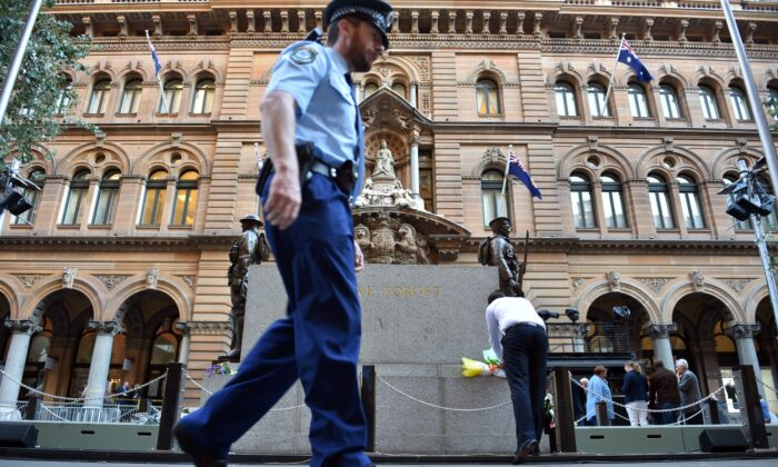 A police officer patrols in front of Sydney Cenotaph in Martin Place on April 24, 2017 (Saeed KhanN/AFP via Getty Images)